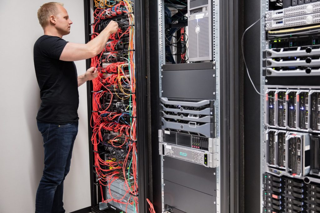 it-technician-checking-with-network-cables-connect-PM4JKEB-scaled